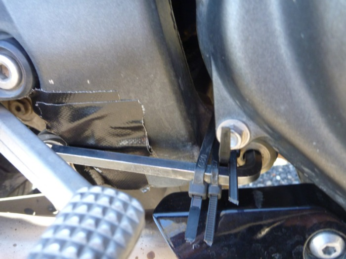 holding the lower engine mount bolt in....!